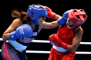 Marlen Esparza (Blue) competes against Karlha Magliocco (Red) (Getty Images)