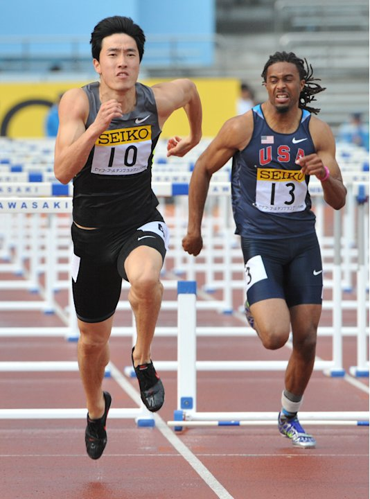 China's Liu Xiang (L) and …