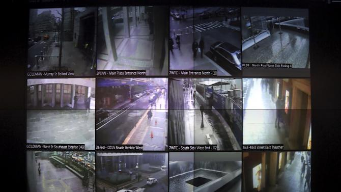 """This Tuesday, Feb. 19, 2013 photo shows a detail of a video wall that shows New York city police officers an interactive map of the area, security footage from nearby cameras, locations where high radiation levels are detected and whether any other threats have been made in New York. The Domain Awareness System, known as """"the dashboard,"""" instantaneously mines data from the NYPD's vast collection of arrest records, 911 calls, more than 3,000 security cameras city-wide, license plate readers and portable radiation detectors and aggregates it into a user-friendly, readable form. (AP Photo/Mary Altaffer)"""