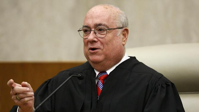 FILE - In this May 1, 2008 file photo, Chief Judge Royce C. Lamberth of the U.S. District Court in Washington is seen in Washington. Lamberth, the outgoing chief judge of the U.S. District Court in Washington says perceptions that a secret court there acts as a rubber stamp for the government are wrong. Lamberth was chief judge of the Foreign Intelligence Surveillance Court from 1995 to 2002. Among other things, the court oversees the National Security Agency's secret surveillance programs, now under scrutiny in the wake of revelations by former NSA contractor Edward Snowden. (AP Photo/Charles Dharapak, File)