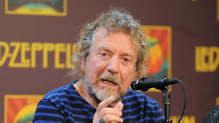 "Led Zeppelin singer Robert Plant participates in a press conference ahead of the worldwide theatrical release of ""Celebration Day"", a concert film of their 2007 London O2 arena reunion show, at the Museum of Modern Art on Tuesday, Oct. 9, 2012 in New York. (Photo by Evan Agostini/Invision/AP)"