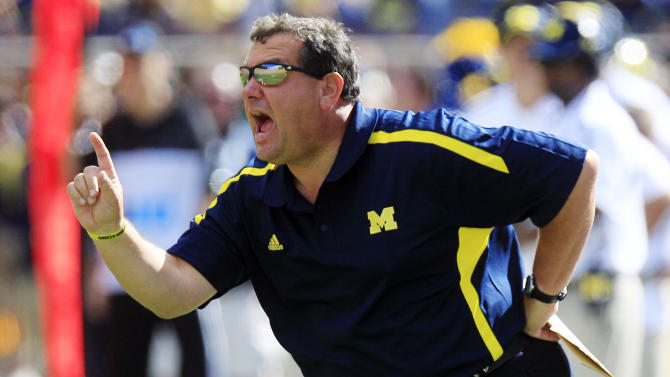 Michigan head coach Brady Hoke yells from the sidelines during the first quarter of an NCAA college football game against Air Force at Michigan Stadium in Ann Arbor, Mich., Saturday, Sept. 8, 2012. (AP Photo/Carlos Osorio)