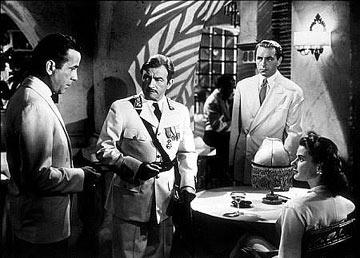 Humphrey Bogart , Claude Rains , Paul Henreid and Ingrid Bergman in Warner Bros. Pictures' Casablanca