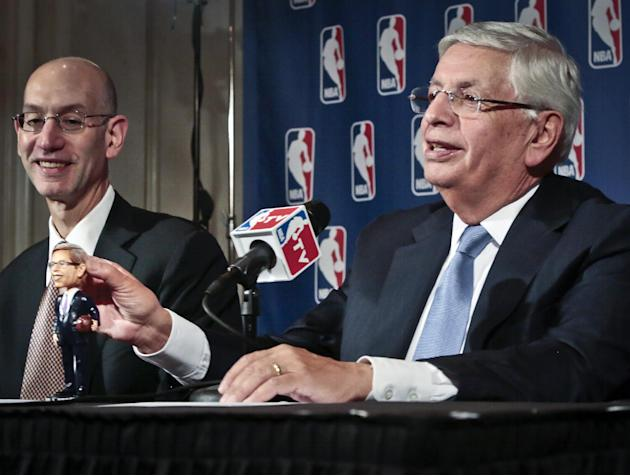 NBA Deputy Commissioner Adam Silver, left, smiles as NBA Commissioner David Stern shows a bobblehead doll in his likeness, during a press conference after a meeting of the NBA board of governors, Wedn