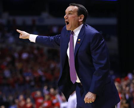 Duke coach Krzyzewski yells instructions to his team during their Midwest Regional NCAA men's basketball game against Louisville in Indianapolis
