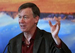 Colorado Governor John Hickenlooper lays out his plans for the next state legislative session at a news conference in his office at the Capitol in Denver
