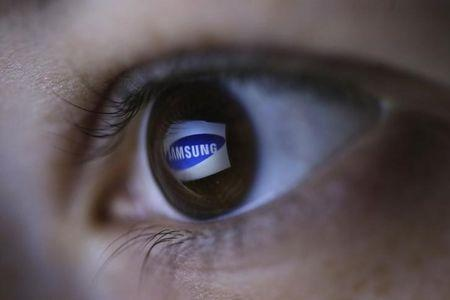 Picture illustration shows Samsung's logo reflected in a person's eye, in central Bosnian town of Zenica