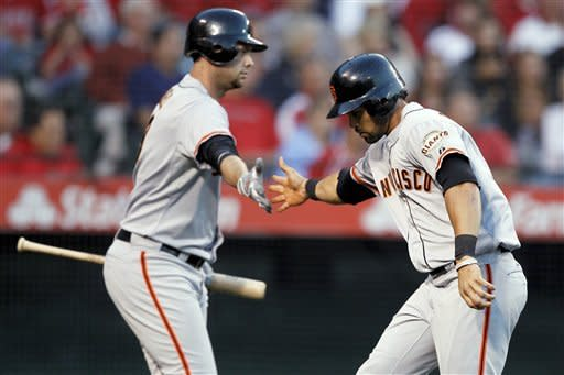 Pujols, Trumbo, Trout batter Giants for 12 runs