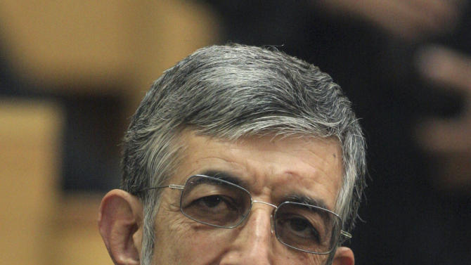 In this photo taken on Nov. 12, 2006, Iranian presidential hopeful Gholam Ali Haddad Adel, a parliament member, looks on in a meeting in Tehran, Iran. For eight years, Iran's President Mahmoud Ahmadinejad has played the role of global provocateur-in-chief: questioning the Holocaust, saying Israel should be erased from the map and painting U.N resolutions as worthless. Now, a race is beginning to choose his successor -- candidate registration starts Tuesday for a June 14 vote -- and it looks like an anti-Ahmadinejad referendum is shaping up. (AP Photo/Vahid Salemi)