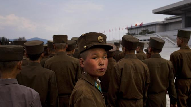 North Korean soldiers tour the park surrounding Kumsusan Palace of the Sun, the mausoleum where the bodies of the late leaders Kim Il Sung and Kim Jong Il lie embalmed, in Pyongyang on Thursday, April 25, 2013. North Korea on Thursday marked the 81st anniversary of the founding of its military, which began as an anti-Japanese militia and now has an estimated 1.2-million troops. (AP Photo/David Guttenfelder)