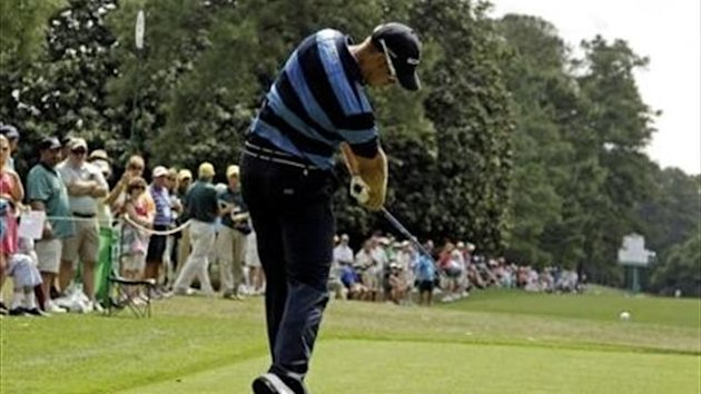 Henrik Stenson, of Sweden, tees off on the ninth hole during the first round of the Masters golf tournament Thursday, April 5, 2012, in Augusta