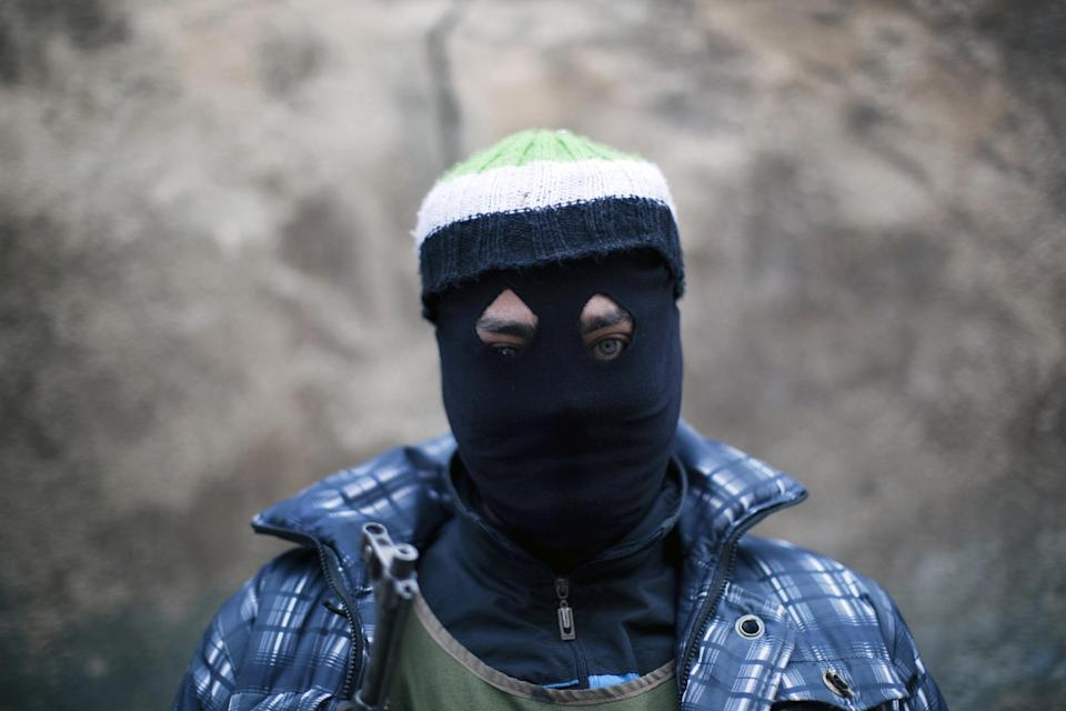 A Free Syrian Army fighter poses for the picture in Idlib, north Syria, Wednesday, March 7, 2012. (AP Photo/Rodrigo Abd)