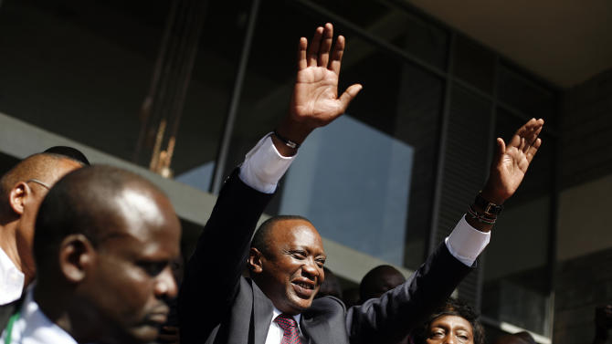 FILE - In this Saturday, March 9, 2013 file photo, Kenya's president-elect Uhuru Kenyatta waves at supporters after winning the elections in Nairobi, Kenya. Kenya's Supreme Court on Saturday, March 30, 2013 upheld the election of Uhuru Kenyatta as the country's next president, in a verdict on a petition by candidate Raila Odinga appealing the election result, ending an election season that riveted the nation amid fears of a repeat of the 2007-08 postelection violence. (AP Photo/Jerome Delay, File)