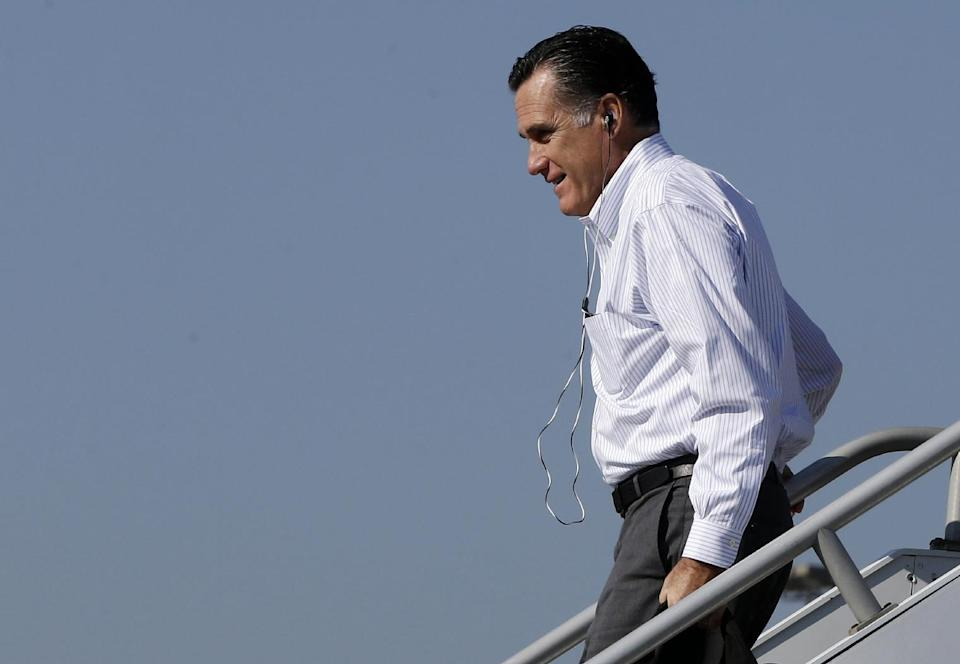 Republican presidential candidate, former Massachusetts Gov. Mitt Romney wears headphones as he steps off his campaign plane at the Blountville-Tri Cities Regional Airport in Blountville, Tenn., Friday, Oct. 5, 2012. ( AP Photo/Charles Dharapak)