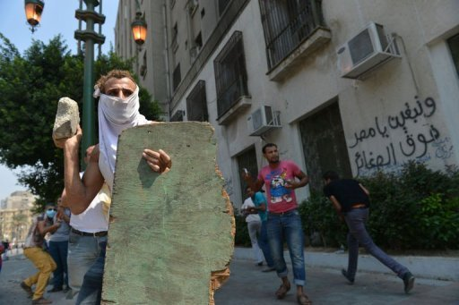An Egyptian protester holds a makeshift shield as he throws a stone towards the riot police during clashes near the US embassy in Cairo on September 13. Saudi Arabia's mufti or spiritual leader Sheikh Abdelaziz al-Sheikh condemned as un-Islamic violent protests against an anti-Muslim Internet film made in the United States