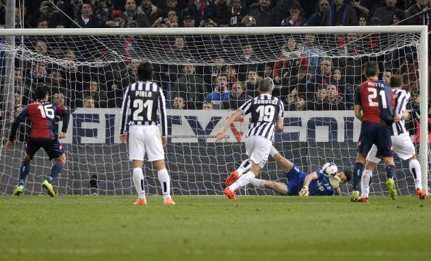Juventus' goalkeeper Gianluigi Buffon saves a penalty shot by Genoa's Emanuele Calaio during their Italian Serie A soccer match at Luigi Ferrari stadium in Genoa
