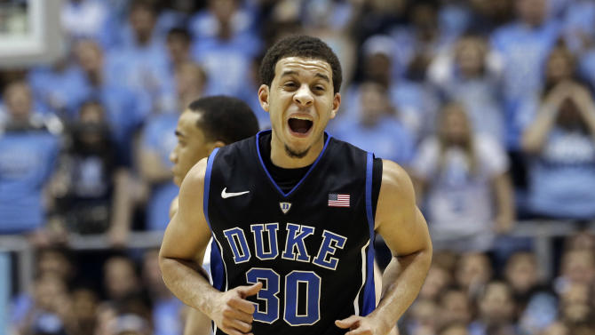 Duke's Seth Curry (30) reacts following a basket against North Carolina during the first half of an NCAA college basketball game in Chapel Hill, N.C., Saturday, March 9, 2013. (AP Photo/Gerry Broome)