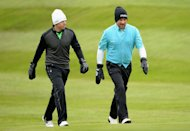 VIRGINIA WATER, ENGLAND - MAY 24:  Rory McIlroy and Graeme McDowell of Northern Ireland walk up the first fairway during the second round of the BMW PGA Championship on the West Course at Wentworth on May 24, 2013 in Virginia Water, England.  (Photo by Ross Kinnaird/Getty Images)