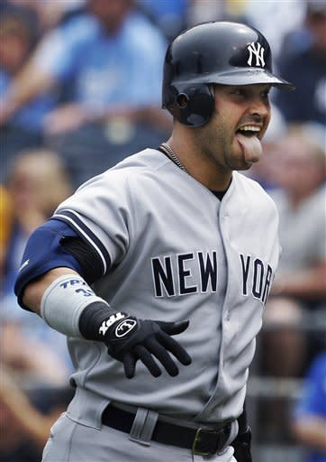 Cano's slam sends Yankees to 10-4 win over Royals