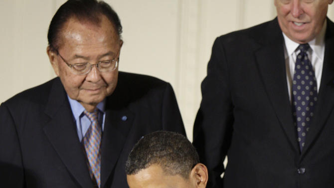 FILE - In this July 24, 2009 file photo, President Barack Obama signs a proclamation celebrating the 19th anniversary of the Americans with Disabilities Act, as Sen. Daniel Inouye, D-Hawaii, left, looks over his shoulder in the East Room at the White House in Washington. Inouye has died of respiratory complications, Monday, Dec. 17, 2012, according to his office. He was 88. (AP Photo/Alex Brandon, File)