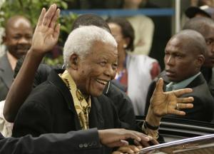 File photo of former South African President Mandela waving as he leaves after casting his vote at a polling station in Houghton, Johannesburg