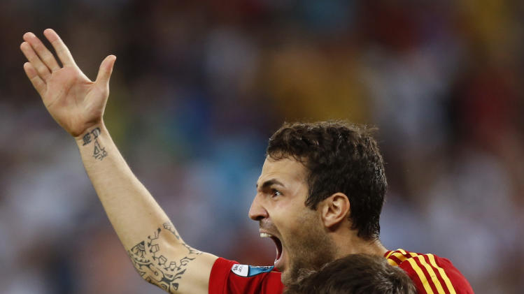 June 28 Spain's Cesc Fabregas celebrates with his teammate Iker Casillas after scoring the decisive penalty shootout during the Euro 2012 soccer championship semifinal match between Spain and Portugal in Donetsk, Ukraine, Thursday, June 28, 2012. (AP Photo/Jon Super)