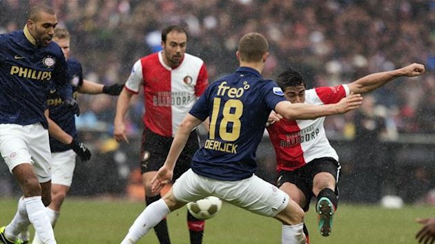 Graziano Pelle of Feyenoord Rotterdam (R) scores past Timothy Derijck of PSV Eindhoven (2nd R) during their Eredivisie match in Rotterdam