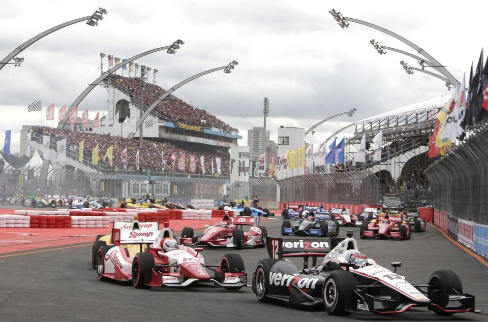 IndyCar driver Will Power, right front, of Australia steers his car on the IndyCar's Sao Paulo 300 track, in Sao Paulo, Brazil, Sunday, April 29, 2012.  (AP Photo/Andre Penner)
