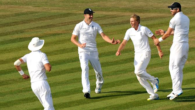England's Joe Root (2nd R) celebrates taking the wicket of India's Shikhar Dhawan on the fourth day of the third cricket Test match between England and India at The Aegeas Bowl cricket ground in Southampton on July 30, 2014