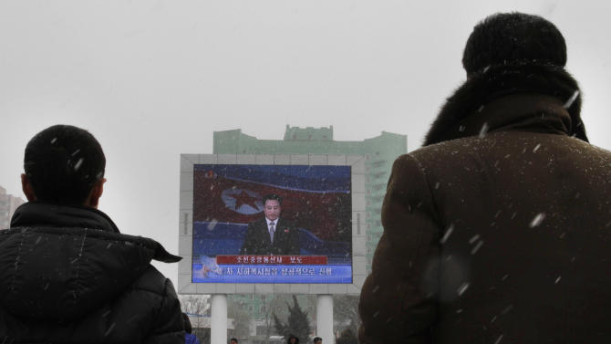 In this Tuesday, Feb. 12, 2013 file photo, on a large television screen in front of Pyongyang's railway station, a North Korean state television broadcaster announces the news that North Korea conducted a nuclear test. North Korea responded with fury over U.N. sanctions following its third nuclear test Feb. 12, and over ongoing U.S.-South Korean military exercises. (AP Photo/Jon Chol Jin)