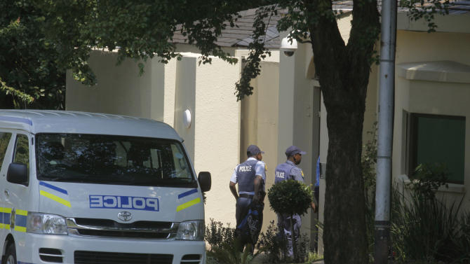 Police enter the home of former president Nelson Mandela in Johannesburg, Monday, Dec. 24, 2012.  Mandela will probably spend Christmas Day in a hospital because his doctors want to be satisfied his health has improved satisfactorily before sending him home, a South African media outlet reported Sunday. (AP Photo/Denis Farrell)