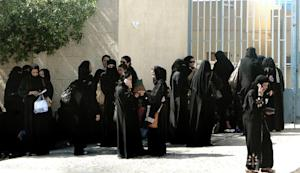 Foreign female workers gather outside the Saudi immigration…