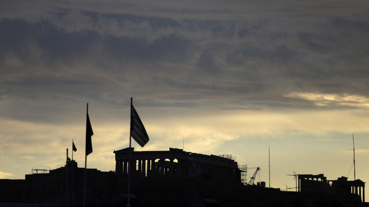 Clouds gather over the Acropolis in Athens at sunset Monday, Oct. 8, 2012, prior to a union anti-austerity rally a day before the visit by German Chancellor Angela Merkel. Greek authorities are keen to prevent embarrassing riots during Merkel's visit. More than 7,000 police will be on security duty in the capital from early Tuesday, while public gatherings will be banned in much of the city center and on a 100-meter radius from the route her motorcade will follow. The ban will not affect the main protests, but will prevent demonstrators from reaching the German embassy, where a populist right wing party was planning a protest. (AP Photo/Dimitri Messinis)
