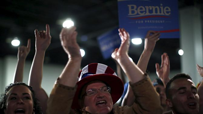Supporters cheer for U.S. Democratic presidential candidate Bernie Sanders at a campaign rally in Denver