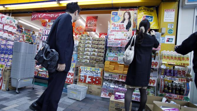 A woman shops at a discount drugstore in Tokyo Friday, Oct. 26, 2012. Japan's Cabinet approved a 423 billion yen ($5.3 billion) economic stimulus package on Friday, moving to fend off recession amid signs the recovery in the world's third biggest economy is faltering. The decision coincided with news of a 0.1 percent fall in the consumer price index in September, adding to pressure on the central bank to ease policies to help fight deflation, or falling prices, which can hinder economic growth. (AP Photo/Koji Sasahara)