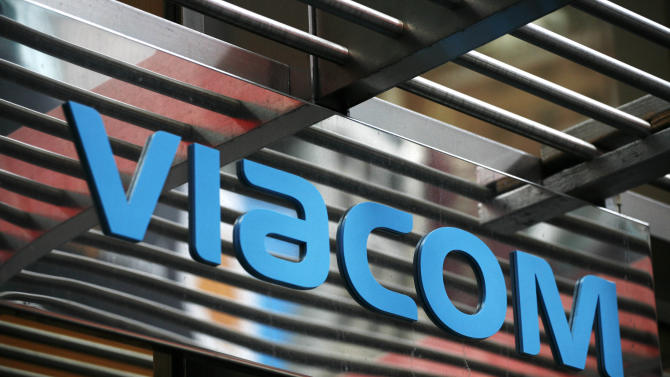 In this photo made Jan. 19, 2010, the entrance to Viacom's headquarters is shown in New York.  Viacom Inc. said Thursday, Jan. 31, 2013, that net income rose sharply in its fiscal first quarter compared with results depressed by a large accounting charge a year ago. But its revenue and adjusted earnings fell because of a decline at its Paramount studio business and lower advertising revenue at its Nickelodeon television channels. (AP Photo/Mark Lennihan)