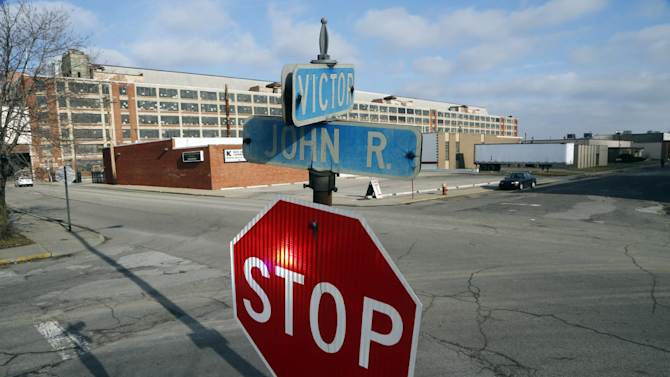 This Dec. 18, 2012 photo shows the intersection of John R. and Victor streets near the site of the country's first mosque led by The Rev. Imam Hussien Karoub, in the shadow of the Ford Motor Co.'s Model T plant, background, in Highland Park, Mich. (AP Photo/Carlos Osorio)