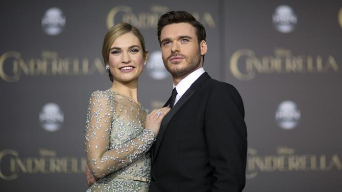 "Cast members Lily James and Richard Madden pose at the premiere of ""Cinderella"" at El Capitan theatre in Hollywood"