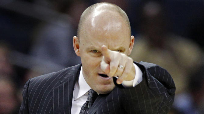 FILE - This Nov. 19, 2012 file photo shows Milwaukee Bucks head coach Scott Skiles directing his team against the Charlotte Bobcats during the second half of an NBA basketball game in Charlotte, N.C. Skiles is out as Bucks head coach and the team says assistant Jim Boylan will take over for the rest of the season. Bucks general manager John Hammond made it official Tuesday, Jan. 8, 2013. (AP Photo/Chuck Burton, File)