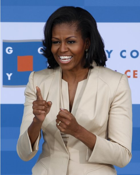 First lady Obama gestures while greeting NATO leaders' spouses and companions during a tour of the Gary Comer Youth Center in Chicago