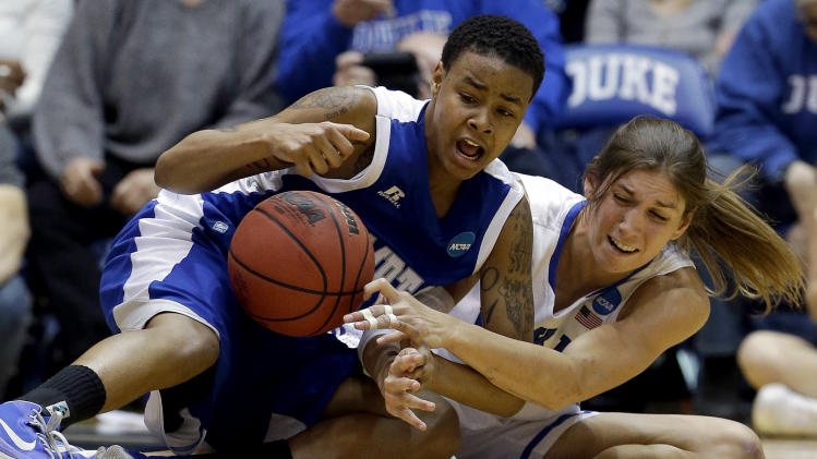 Duke's Allison Vernerey, right, and Hampton's Nicole Hamilton struggle for possession of the ball during the second half of a first-round game in the women's NCAA college basketball tournament in Durham, N.C., Sunday, March 24, 2013. Duke won 67-51. (AP Photo/Gerry Broome)