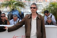 "French director Leos Carax poses during the photocall of ""Holy Motors"" presented in competition at the 65th Cannes film festival. Who cares about the audience? They'll soon all be dead anyway, French auteur Leos Carax told Cannes without a blush on Wednesday, saying he makes his films for himself"