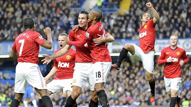Manchester United players celebrate scoring a goal against Chelsea during the English Premier League soccer match between Chelsea and Manchester United at Stamford Bridge