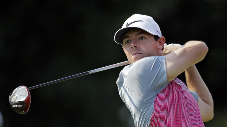 Rory McIlroy, from Northern Ireland, watches his tee shot on the 14th hole during the second round of the Bridgestone Invitational golf tournament Friday, Aug. 1, 2014, at Firestone Country Club in Akron, Ohio. McIlroy finished the day at 7-under par for the tournament, four shots back of leader Sergio Garcia. (AP Photo/Mark Duncan)