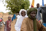 Touareg people celebrate in Diafouke as Malian and French soldiers entered the historic city of Timbuktu, occupied for 10 months by Islamists who imposed a harsh form of sharia, on January 28, 2013