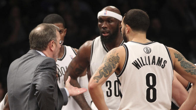 Brooklyn Nets head coach P.J. Carlesimo, left, talks with Joe Johnson, second from left, Reggie Evans, second from right and Deron Williams (8) during a timeout during the second half of NBA basketball game, Friday, March 8, 2013, in New York. The Nets won 95-78. (AP Photo/Mary Altaffer)