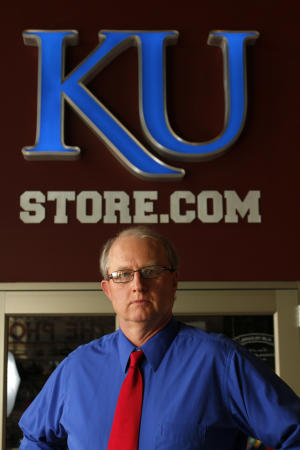 Paul Vander Tuig, trademark licensing director at Kansas University, pose for a photograph by the gift store at Allen Fieldhouse in Lawrence, Kan. With the launch of the first public sale of .xxx domains, Kansas University has purchased .xxx domains to protect its school and brand from being linked to pornographic sites. (AP Photo/Ed Zurga)