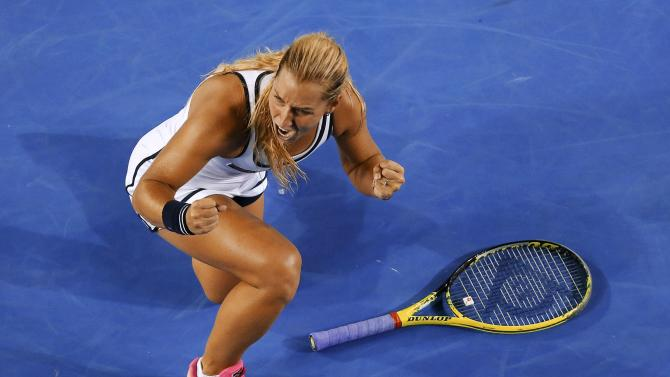 Cibulkova of Slovakia celebrates after defeating Azarenka of Belarus during their women's singles fourth round match at the Australian Open 2015 tennis tournament in Melbourne