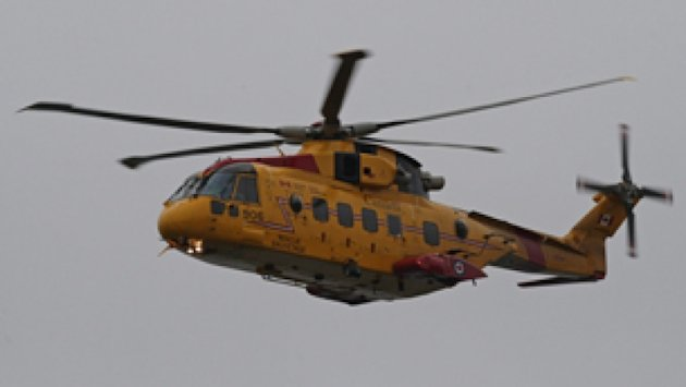 Two Cormorant helicopters are helping rescue crew members from a cargo ship off the coast of Newfoundland.