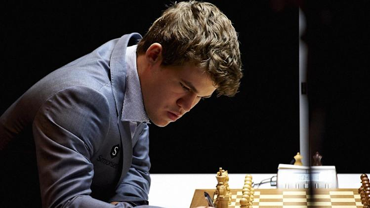 Norway's Magnus Carlsen writes his move as he plays against India's Viswanathan Anand, unseen, in the Norway Chess 2013 tournament in Sandnes near Stavanger, Norway, Thursday May 9, 2013. (AP Photo/NTB Scanpix, Kent Skibstad)  NORWAY OUT